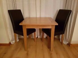 Oak table and two chairs