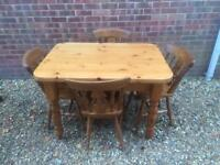 Solid chunky pine dining table and 4 chairs. 4ft x 3ft. 2 inch thick