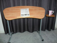 Adjustable Tilting Over Armchair Table with attached refreshments table from Patterson Medical