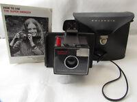 Vintage Super swinger polaroid land camera in orginal case & paperwork