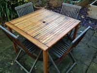 Australian hardwood outdoor dining table and four chairs