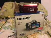 Panasonic HC - V10 camcorder in red