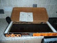 Saltron Hot tray in working order with a microwave hot plate.