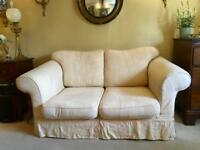 Free for collection. Two seater sofa with two sets of loose covers