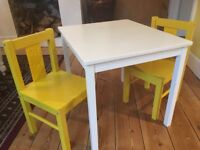 For Sale: White Children's Sundvik Table and 2 yellow chairs