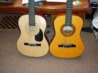2 acoustic midsize guitars