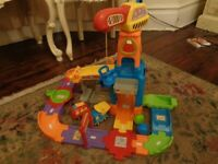 Vtech toot toot drivers construction site. Boxed with extra vehicle.