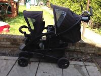 Graco double buggy with two foot muffs, two reclinable seats.
