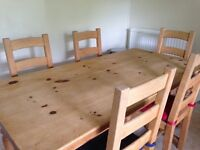 Pine dining table 6' x 3' and 6 high back chairs in good condition.