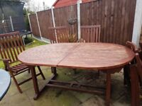 Extendable teak table and 6 chairs- SOLD pending collection -