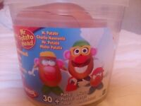 Mr Potato Head and Family Bucket 30 pieces plus. Excellent condition and complete