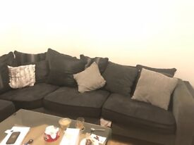 Corner sofa and Round chair black and grey good condition