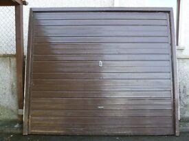 Metal brown garage door up and over with wooden frame