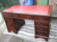 Antique reproduction mahogany pedestal desk with red leather writing surface 54ins wide