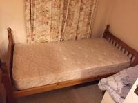 Wooden single bed frame with mattress