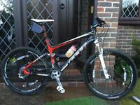 Full carbon full suspension mountain bike like new had for about 5 years hardly ever ridden