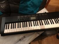 Casio keyboard with cover and stand