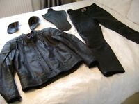 Leather motorbike jacket and trousers by Hein Gericke