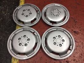 "15"" Wheel Trims One has been touched up with silver paint. All clips intact. £15"