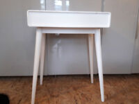 White dressing table with mirror.