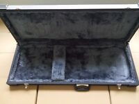 Hard case for electric guitar.
