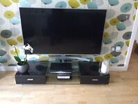 Black gloss/glass tv stand,good condition,2 person lift