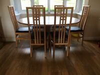 Ercol light wood dining table and 6 chairs(not Ercol)