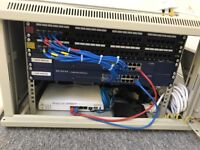 Comms cabinet with 2 x 24 ports and 2x 16 net gear ports also contains Draytek dual band modem