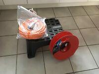 Caravan/motorhome electric cable, reel and step