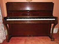 Modern upright piano, good condition.