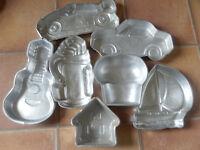 Set of 7 Wilton tins Hobby themed:Guitar, Golf Bag, Car,Formula1 Racing Car,Yacht,CupCake,House,