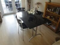 Dining/Kitchen Table. Chrome and Black Glass Top (L 110 cm & W 70cm). Matching seats. Ex Condition.