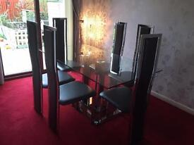 Glass & Chrome dining table & chairs SOLD