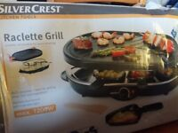 Raclette grill, never used, comes with 4 small pans and 8 wooden spatulas.