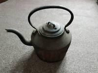 Large cast iron kettle.