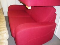 TWO MATCHING RED SOFAS