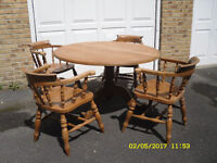 Pine circular table and 4 chairs.