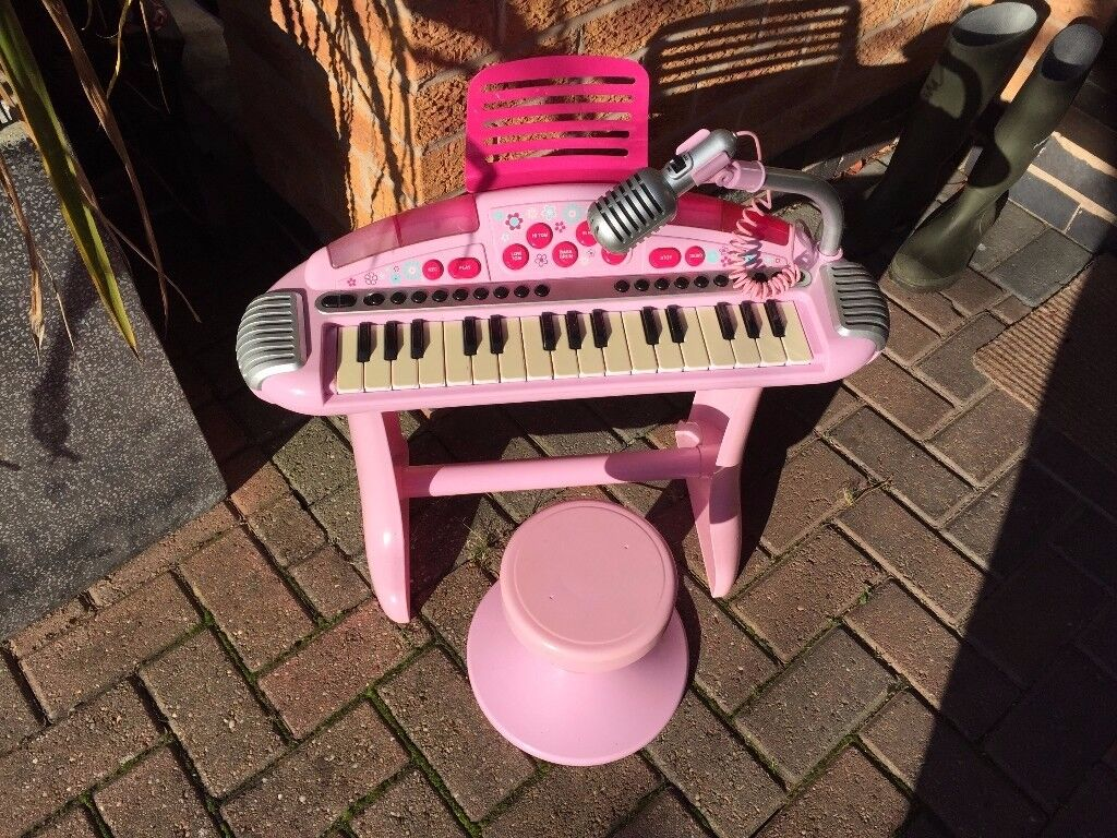 Child's pink keyboard with stool, from ELC