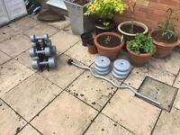 Weights for sale. Curling bar & weights with Dumbells.
