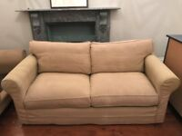 Double sofa bed. Detachable arms for easy house moving. Feather back cushions. Very comfortable.