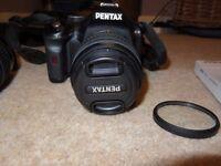 Digital SLR Pentax K-x Camera with 2 Lenses, Ultra Violet Filter and Carry Case