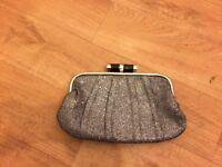 Sparkly silver clutch bag