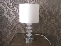 Cream colour shade, glass and silver stand Table lamp