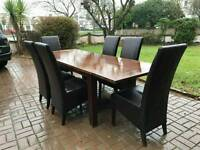 extendable dinning table and 6 leather chairs