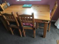 Rustic pine table and four chairs