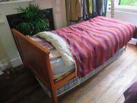 Single Bed, plus spare mattress.