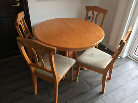 Solid oak round dining table and 4 upholtered chairs