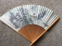 Decorative chinese folding paper and bamboo fan.