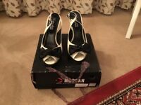 Morgan ladies sling back patent Beige and Black sandals with bow. Size 5. Worn few times only
