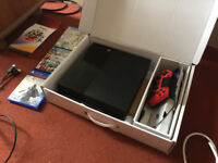 PS4 for sale with one controller and 3 games boxed